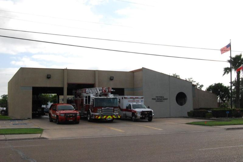 Victoria Fire Department Station 1, with three vehicles parked outside