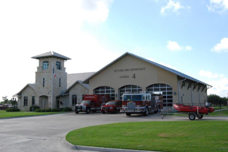 Victoria Fire Department Station 4 with three emergency services vehicles parked outside
