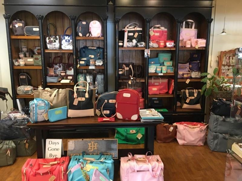 Display shelves of various colors and sizes of purses and bags.