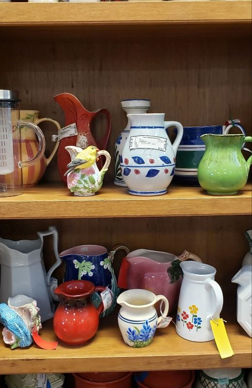 Pitchers being displayed in a Bookshelf at Twice Blessed